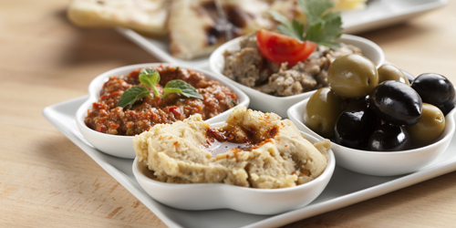 platter of mixed dips,flat bread and olives