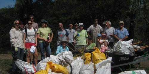 Group with rubbish they have collected as part of CUAD