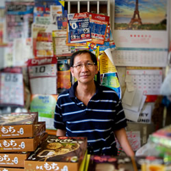 A shop assistant at an Asian grocery store in Preston