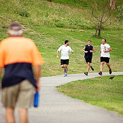 Runners on Edwardes Lake Park track