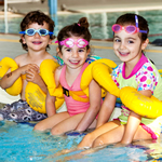 Three kids in floaties at Reservoir Leisure Centre