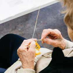 An older lady knitting - Older and Active Newsletter
