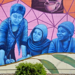 women depicted in mural on prace building
