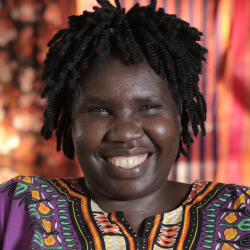 An African women smiling at the camera